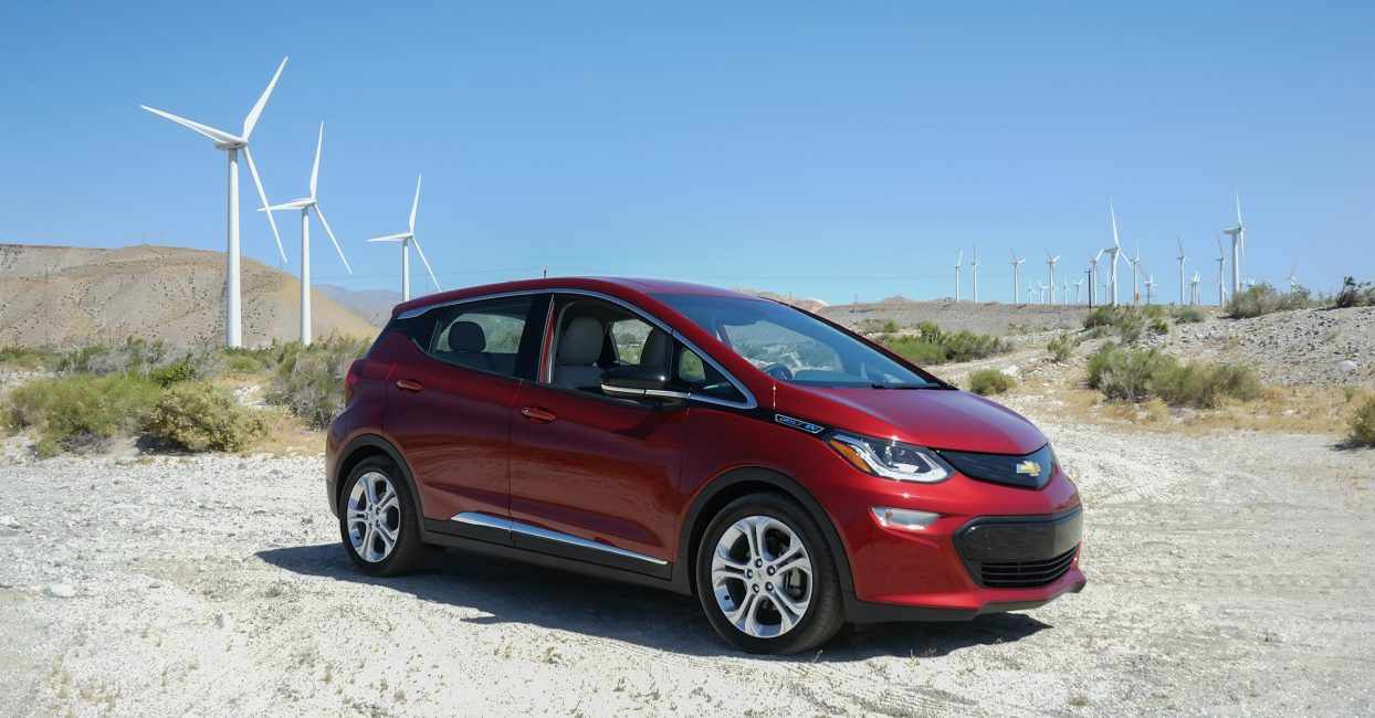 Music festival goers stop for a photo opp with their Bolt EV at iconic Indio, California stops.